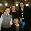 Nicolas & Max Krzywiec of Lemont celebrate with their Grandmother at Everest Academy.