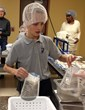"John Beecher, a 4th grader at Everest Academy, puts faith into action at ""Feed My Starving Children"" in Aurora, helping to stop hunger one meal at a time."