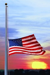 The United States Flag at half staff.