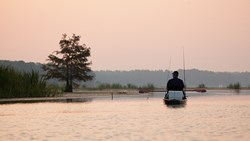 A photo of a kayak fisherman