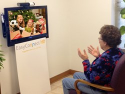 Senior resident video conferencing with family using EasyConnect HD.