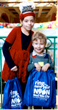 Eliana, 8 and Joseph, 4, of Scarsdale enjoy receiving their Ring in the New Year goodie backpack.