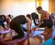 Sacramento yoga teacher Kate Saal assisting a student.