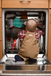 kids emptying the dishwasher