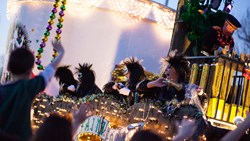 A photo of float riders at Mardi Gras