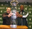 Shilique Calhoun and Head Coach Mark Dantonio with the CFPA Trophy