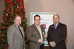 Gary Tonniges, Jr., CEO of TriQuest Technologies, Inc. Accepts the Greater Tarrant Business Ethics Award.  Also pictured, Tarrant County Judge Glen Whitley and Brian Lixley of BB&T