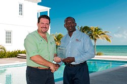 Zack accepts BCA award from the Bahamian Contractors' Association.