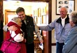 Retired Mayor Sandra Bigler and newly elected Mayor Dave Blackham share a friendly hug at museum opening.