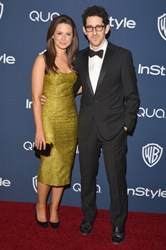 Actress Katie Lowes with the Jill Milan Octagon clutch at InStyle/Warner Bros. Golden Globe party, here with actor/producer Adam Shapiro. Jan 12, 2014, Beverly Hills. (Photo: Lester Cohen/WireImage)