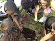 Kids planting saplings for Trees for Wildlife
