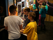 Students at Pioneer Middle School learn about the Canadian Honours System through interactive displays in the exhibit.