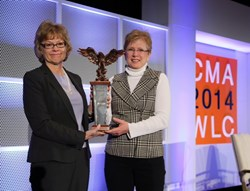 Donna Harman, immediate past president of CMA, left, present ISA president and CEO Lori Anderson with CMA's Leadership Award