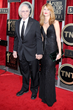 Laura Dern (R) carries the Jill Milan New Canaan Clutch to 20th Annual SAG Awards with her father Bruce Dern, Jan 18 2014 in Los Angeles. (Photo: Kevork Djansezian, Getty Images)