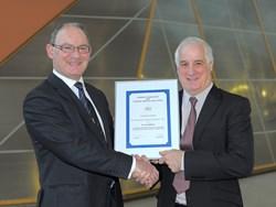 Chris Eady presenting Alan Robinson with EWF Award Certificate