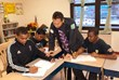 Project GOAL instructor Javier Gallego (center) assists Calcutt Middle School students Kevin Moreira. (left) and Junior Varela. with math homework. Also pictured (background) is Evanilson Gomes., anot