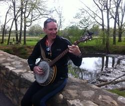 Col. John Sims and his banjo.