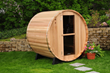 Almost Heaven barrel sauna in backyard.