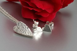 Silver pendant and earrings
