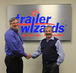 Doug Vanderspek, President of Trailer Wizards, and Tibor Varga, President of Max-Atlas Equipment International Inc., announce a dealership partnership.