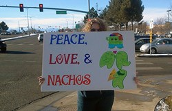 CCA student Gene Dillon brightens the days of some Aurora, Colorado commuters with an inventive sign.