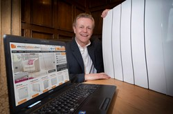 Eco Stores Direct founder Paul Walker with one of the firm's energy efficient electric radiators