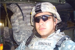 SSG Ernest Gonzalez pictured in army fatigue uniform and helmet was injured in Iraq in 2006 and has had trouble sleeping ever since his injury.  He is sleeping better now thanks to new adjustable bed donation from Easy Rest Adjustable Sleep Systems.