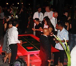 Table talk: Guests at the event socialised around casino stations, gambling with 'charity chips' to raise money for the Pure Blue Foundation.