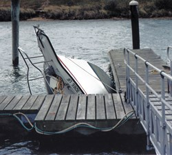Boat sinking at dock