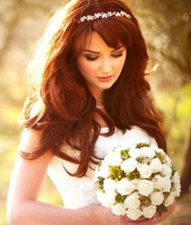 bride with bouquet in sunlight