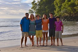 All ages enjoy the private beach at Tulemar Resort in Costa Rica