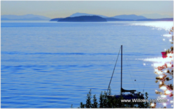 The blue of the strait and islands of the San Juans from the deck of The Willows Inn on Lummi Island.