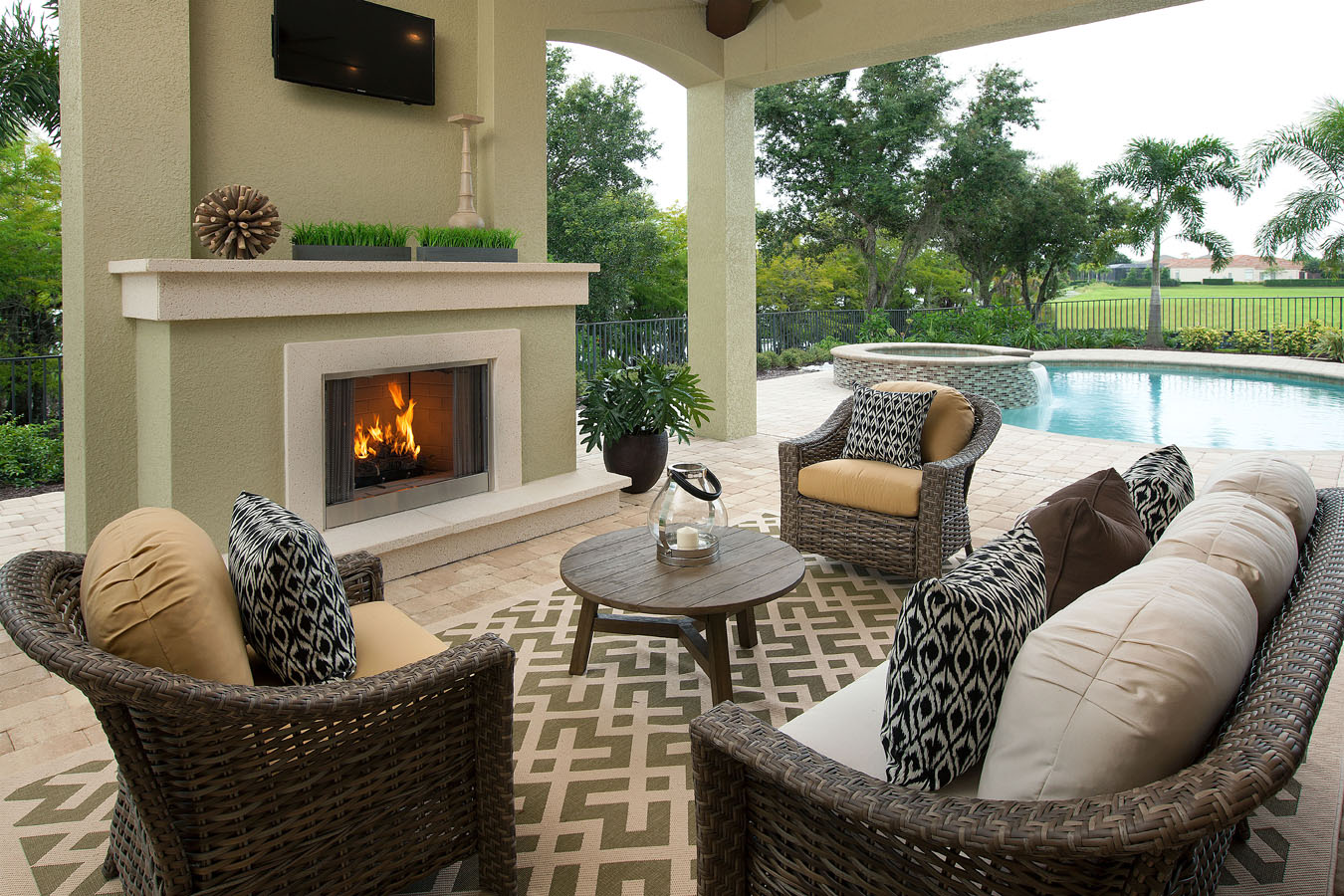 Beasley henley interior design unveils interior design for Outdoor rooms with fireplaces