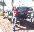 MonaVie distributor Cody Van Camp poses with his new Jeep