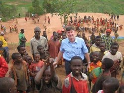 Nick Jordan, Wells of Life founder, spends quality time with the young villagers during his 2008 trip to Uganda.