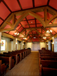 Woodland Modified Arched King Truss Faux Wood Beams, in a church.
