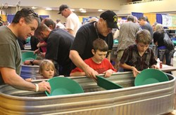 Gold and Treasure Expo attendees learn to pan for real gold!