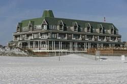 green and white beachfront hotel