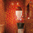 In the bathroom, walls of red mosaic tile from Granite Transformations' Liberty collection, made in part from recycled glass, command attention.