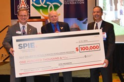 From left, SPIE President Philip Stahl, James Wyant, and OSC Dean Thomas Koch celebrate a donation to a new 4-to-1 matching scholarship program enabled by a gift from Wyant.