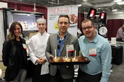 Global Distributions team exhibiting at the Tri-state food Expo, New Jersey, october 2013