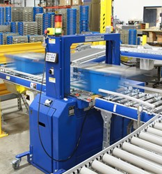 Mosca strapping machine seals tote boxes in warehouse & distribution center