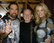 Recipients of the Ann Richards Founders Award, John Paul and Eloise DeJoria,with Willie Nelson at the inaugural Nobelity Project Dinner