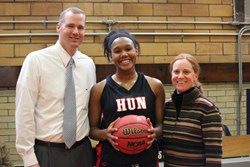 Coaches William Holup and Julie Davis congratulate Johnnah Johnson '14 on February 8th during the Mid-Atlantic Prep League Tournament at The Hill School.