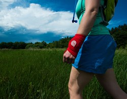 Trail Runner with a Dr. Cool Recovery-On-The-Go Wrap