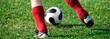 child kicking soccer ball