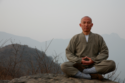 Shi DeRu in Meditation at the backyard of the temple
