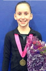 Head Over Heels Athletic Arts in Emeryville, CA trains Junior Division Courtney Klausen, age 12, won the All-Around title