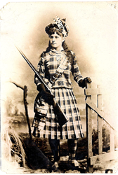 In this photo taken in 1891 in Glasgow, Scotland, sharpshooter Annie Oakley shows off her custom tartan outfit. Photo courtesy of the Garst Museum of Greenville, Ohio.