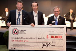 Jay Kumler of Jenoptik (at left) and SPIE President Philip Stahl (right) congratulate 2014 Startup Challenge first-place winner Robert McLaughlin of the University of Western Australia. (Photo: Joey Cobbs for SPIE.)